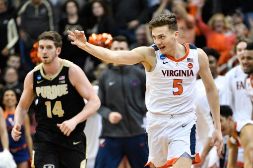 Mar 30, 2019; Louisville, KY, United States; Virginia Cavaliers guard Kyle Guy (5) reacts after making a three-pointer during the second half in the championship game against the Purdue Boilermakers of the south regional of the 2019 NCAA Tournament at KFC Yum Center. Mandatory Credit: Jamie Rhodes-USA TODAY Sports