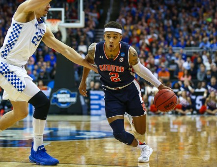 Mar 31, 2019; Kansas City, MO, United States; Auburn Tigers guard Bryce Brown (2) dribbles the ball against Kentucky Wildcats forward Reid Travis (22) in the championship game of the midwest regional of the 2019 NCAA Tournament at Sprint Center. Mandatory Credit: Jay Biggerstaff-USA TODAY Sports