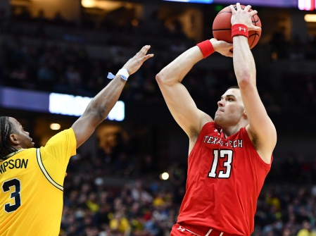 Mar 28, 2019; Anaheim, CA, USA; Texas Tech Red Raiders guard Matt Mooney (13) shoots over Michigan Wolverines guard Zavier Simpson (3) in the semifinals of the west regional of the 2019 NCAA Tournament at Honda Center. Mandatory Credit: Robert Hanashiro-USA TODAY Sports